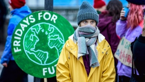 "Swedish environmental activist Greta Thunberg attends a climate strike arranged by the organization ""Fridays For Future"" outside the Swedish parliament Riksdagen in Stockholm, Friday Dec. 20, 2019. (Pontus Lundahl/TT via AP)"