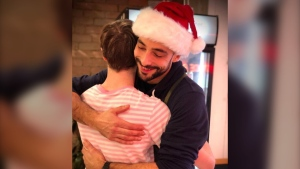The owner of Julian's Comptoir is offering free hugs to anyone feeling lonely during the holidays. (Credit: Julian's Comptoir)
