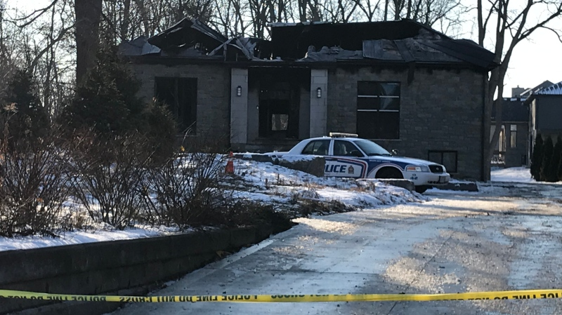 Police guard the scene of a suspicious fire in London, Ont. on Friday, Dec. 20, 2019. (Sean Irvine / CTV London)