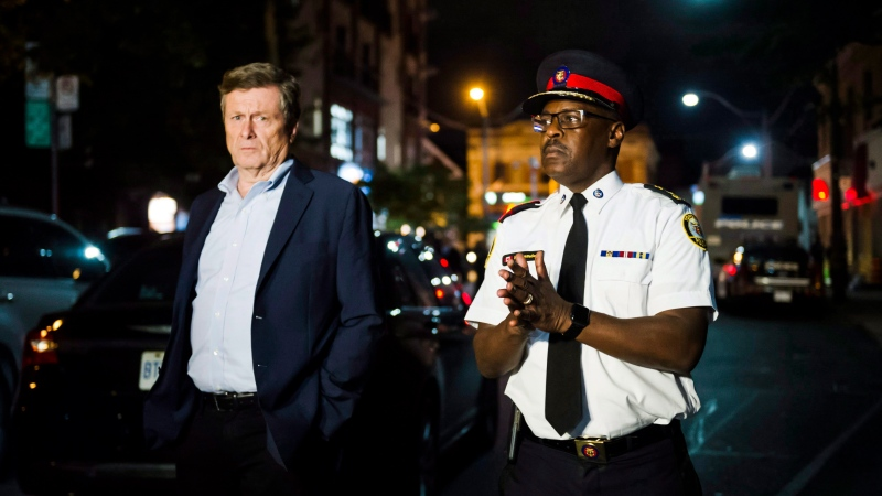 Toronto mayor John Tory and police chief Mark Saunders speaks to press following a mass casualty event in Toronto on Sunday, July 22, 2018. THE CANADIAN PRESS/Christopher Katsarov