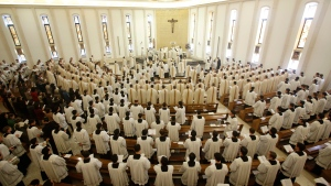 Prelates attend a mass celebrated by Cardinal Velasio De Paolis in the Legion of Christ main headquarters, the Ateneo Pontificio Regina Apostolorum, in Rome, Tuesday, Feb. 25, 2014. (AP Photo/Riccardo De Luca)
