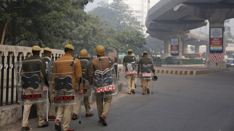 Police patrol a street in Lucknow, Uttar Pradesh state, India, Sunday, Dec. 22, 2019. (AP Photo/Rajesh Kumar Singh)