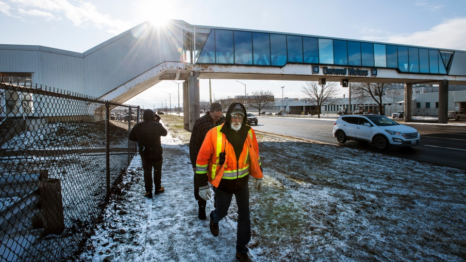 Workers leave work on their last day outside the General Motors plant in Oshawa, Ontario on the final day of production on Wednesday December 18, 2019. THE CANADIAN PRESS/Aaron Vincent Elkaim