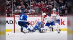 Montreal Canadiens' Brendan Gallagher (11) skates after a loose puck as Winnipeg Jets' Neal Pionk (4) and goaltender Laurent Brossoit (30) defend their goal during second period NHL action in Winnipeg on Monday Dec. 23, 2019. (Source: The Canadian Press/Fred Greenslade)