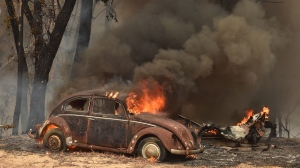 An old Beetle burns from bushfires in Balmoral, Australia, which is located 150 kilometres southwest of Sydney. (PETER PARKS/AFP via Getty Images)