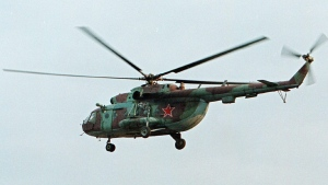 In this in this Sept. 18, 2002 file photo a Mi-8 helicopter flies over the Chechen regional capital Grozny, Russia. A helicopter similar to the one pictured made a rough emergency landing in Russia on Wednesday, injuring 15. (AP Photo/Musa Sadulayev, File)