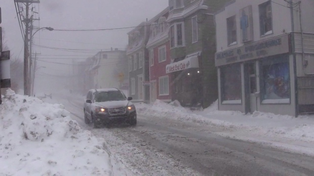 In this file photo, a car drives downs a snow-covered street in St. John's on Wednesday, Jan. 2, 2019. (THE CANADIAN PRESS / Holly McKenzie-Sutter)