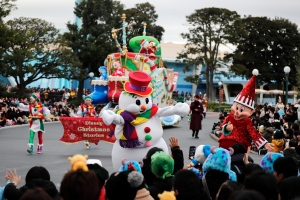 Performers dressed in Christmas costumes cheer on visitors during the Disney Christmas Stories parade held at Tokyo Disneyland in Urayasu, near Tokyo, Japan, Wednesday, Dec. 25, 2019. (AP Photo/Andy Wong)
