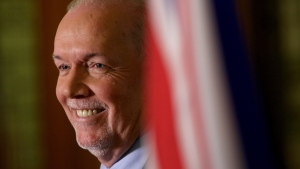 Premier John Horgan answers questions at a press conference in the Hall of Honour at B.C. Legislature in Victoria, B.C., on Monday, October 7, 2019. THE CANADIAN PRESS/Chad Hipolito