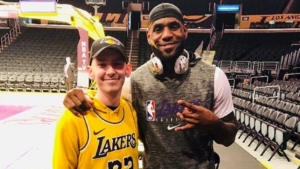Corey Groves and LeBron James are seen at the Staples Center. (Instagram / @coreylakerfan)