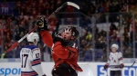 Canada's Alexis Lafreniere celebrates after scoring his sides fifth goal during the U20 Ice Hockey Worlds match between Canada and the United States in Ostrava, Czech Republic, Thursday, Dec. 26, 2019. (AP Photo/Petr David Josek)