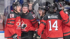 Canada's Alexis Lafreniere (11) celebrates his goal with teammates Nolan Foote (29), Ty Smith (24), Jared McIsaac (14) and Joe Veleno(90) during third period action against the United States at the World Junior Hockey Championships in Ostrava, Czech Republic, Thursday, Dec. 26, 2019. THE CANADIAN PRESS/Ryan Remiorz