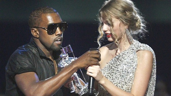 Kanye West takes the microphone from singer Taylor Swift as she accepts the 'Best Female Video' award during the MTV Video Music Awards on Sunday, Sept. 13, 2009 in New York. (AP / Jason DeCrow)