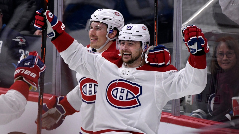Montreal Canadiens' Tomas Tatar (90) celebrates his second goal against the Winnipeg Jets with teammate Brendan Gallagher (11) during first period NHL action in Winnipeg on Monday Dec. 23, 2019. THE CANADIAN PRESS/Fred Greenslade