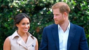 In this Wednesday Oct. 2, 2019 file photo, Harry and Meghan, Duchess of Sussex arrive at the Creative Industries and Business Reception at the British High Commissioner's residence, in Johannesburg. (Dominic Lipinski/Pool via AP, File)