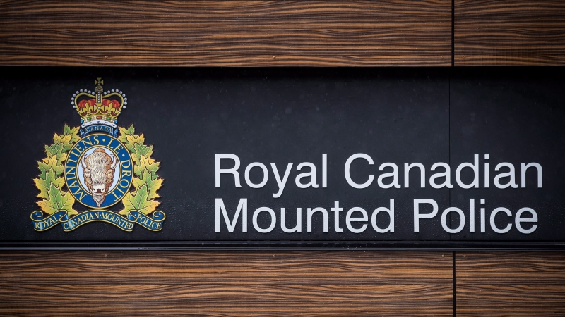 "The RCMP logo is seen outside Royal Canadian Mounted Police ""E"" Division Headquarters, in Surrey, B.C., on April 13, 2018. (File photo)"