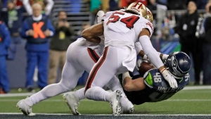 Seattle Seahawks tight end Jacob Hollister (48) is stopped just short of the goal line by San Francisco 49ers middle linebacker Fred Warner (54) and linebacker Dre Greenlaw, left, during the second half of an NFL football game, Sunday, Dec. 29, 2019, in Seattle. The 49ers won 26-21. (AP Photo/Ted S. Warren)
