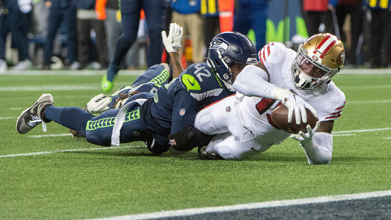 San Francisco 49ers receiver Deebo Samuel gets stopped short of the goal line by Seattle Seahawks defensive back Lano Hill in an NFL football game in Seattle on Sunday, Dec. 29, 2019. (Drew Perine /  The News Tribune via AP)