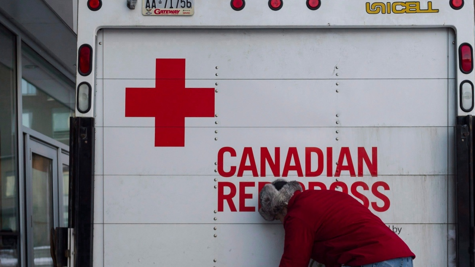 Bill Behse of the Canadian Red Cross checks the contents of an emergency shelter unit. (THE CANADIAN PRESS/Christopher Katsarov)