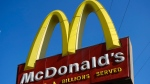 A McDonald's sign is seen above the fast food restaurant on Monday, Nov. 25, 2019 near downtown Los Angeles. (AP Photo/Richard Vogel)