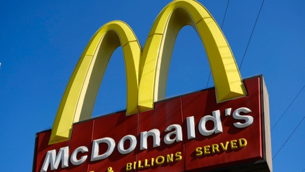 A McDonald's sign is seen above one of the fast food chain's locations in downtown Los Angeles. (AP Photo/Richard Vogel)