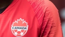 A Canada soccer logo is seen on Alphonso Davies in Vancouver on March 24, 2019. THE CANADIAN PRESS/Darryl Dyck