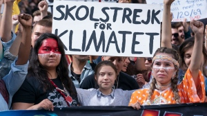 Swedish activist and student Greta Thunberg, centre, takes part in the Climate Strike in Montreal on Friday, September 27, 2019. THE CANADIAN PRESS/Paul Chiasson