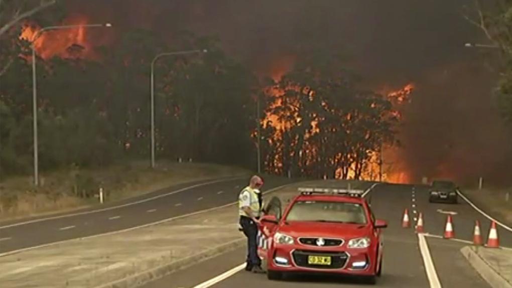 Thousands to sleep at beaches as fires encircle Australian towns