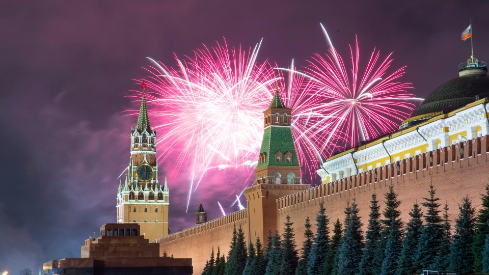 Fireworks explode over the Kremlin during New Year's celebrations in Red Square with the Spasskaya Tower, second right, in the background in Moscow, Russia, Wednesday, Jan. 1, 2020. (AP Photo/Denis Tyrin)
