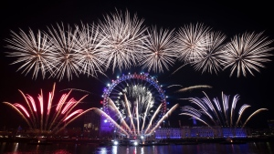 Fireworks explode over the London Eye Ferris wheel by the River Thames in London, to mark the start of the new year, Wednesday, Jan. 1, 2020. (AP Photo/Matt Dunham)