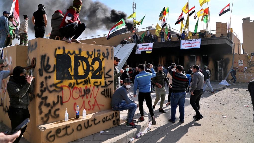 Militiamen withdraw from U.S. Embassy but Iraq tensions linger
