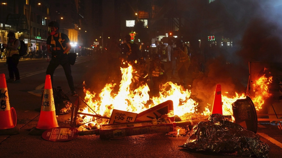 Fire set by protesters in Hong Kong