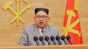 """FILE - In this Jan. 1, 2018, file photo provided by the North Korean government, North Korean leader Kim Jong Un delivers his New Year's speech at an undisclosed place in North Korea. Kim's threat to show the world a new strategic weapon and possibly resume long-range missile tests is another dramatic turn in his high-stakes summitry with President Donald Trump. Korean language watermark on image as provided by source reads: """"KCNA"""" which is the abbreviation for Korean Central News Agency. (Korean Central News Agency/Korea News Service via AP, File)"""