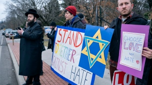 Neighbours gather to show their support of the community near a rabbi's residence in Monsey, N.Y., Sunday, Dec. 29, 2019, following a stabbing Saturday night during a Hanukkah celebration. (AP Photo/Craig Ruttle)
