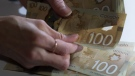 Canadian $100 bills are counted in Toronto, Feb. 2, 2016. THE CANADIAN PRESS/Graeme Roy