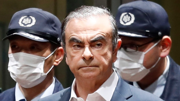 Two accused of smuggling ex-Nissan boss out of Japan in a box