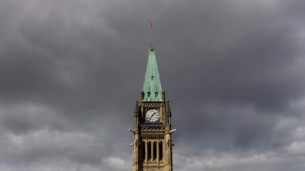 Storm clouds move in over the Peace Tower on Parliament Hill in Ottawa, Sunday, Sept. 13, 2009. (Adrian Wyld / THE CANADIAN PRESS)