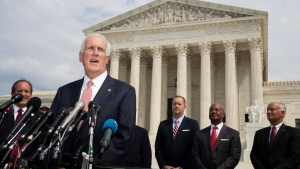 In this Sept. 9, 2019 file photo, Tennessee Attorney General Herbert Slatery, with a bipartisan group of state attorneys general speaks to reporters in front of the U.S. Supreme Court in Washington. Slatery asked the state Supreme Court to set nine execution dates, bucking a national movement away from capital punishment. (AP Photo/Manuel Balce Ceneta, File)