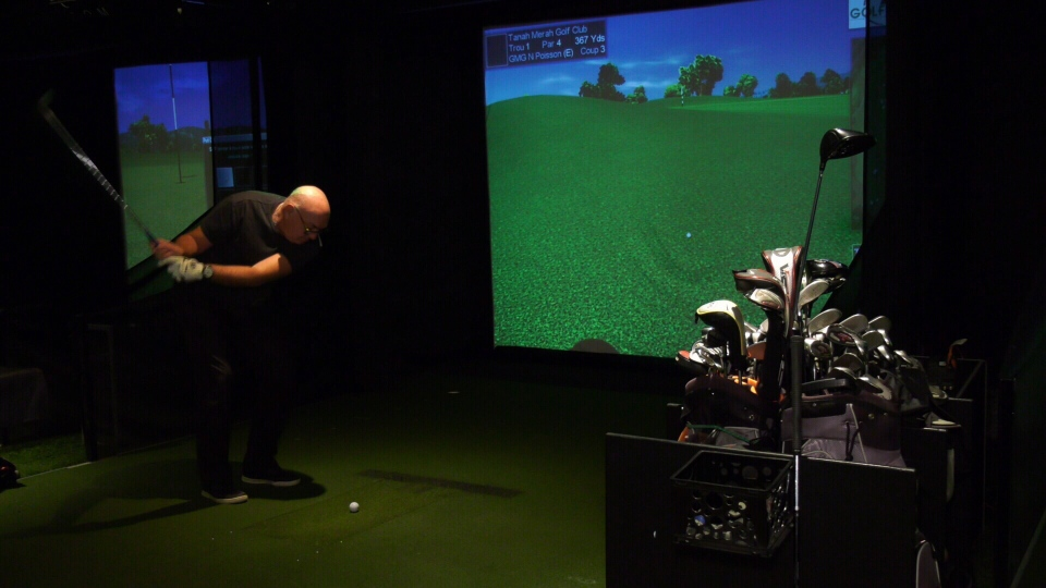 Norm Poisson is a regular at the Centre de golf Carlo Bertrand that offers a virtual tour for those wanting to play the sport through the winter.