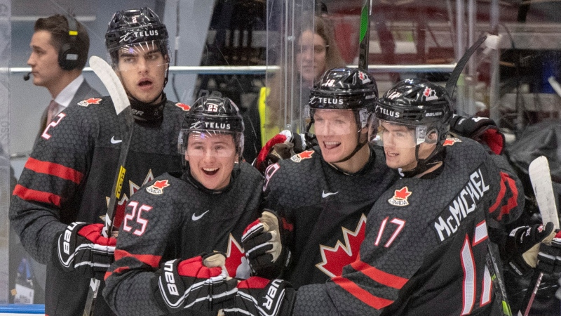 Canada's Ty Dellandrea (18) celebrates with teammates Kevin Bahl (2) Aidan Dudas (25) and Connor McMichael (17) after scoring the fourth goal against Finland during first period semifinal action at the World Junior Hockey Championships on Saturday, January 4, 2020 in Ostrava, Czech Republic. THE CANADIAN PRESS/Ryan Remiorz