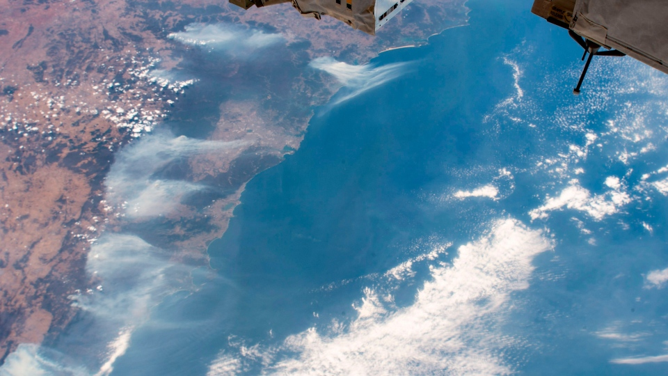 This image taken from the International Space Station on Friday, Jan. 3, 2020 shows wildfires surrounding Sydney Australia as the ISS orbited 269 miles above the Tasman Sea. (NASA via AP)