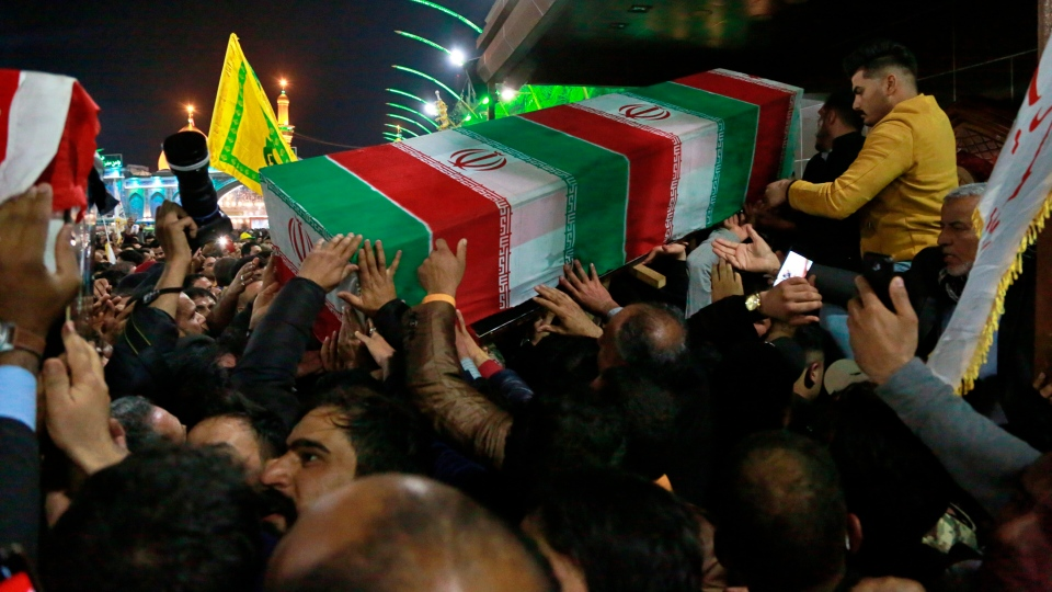 Mourners carry the coffin of Iran's top general Qassem Soleimani during his funeral in Karbala, Iraq, Saturday, Jan. 4, 2020. (AP Photo/Khalid Mohammed)