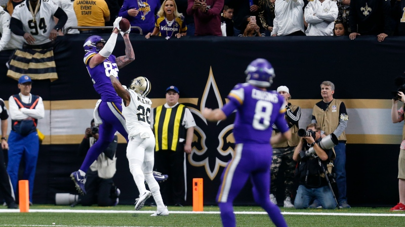 Minnesota Vikings tight end Kyle Rudolph (82) pulls in the game winning touchdown pass over New Orleans Saints cornerback P.J. Williams (28) during overtime of an NFL wild-card playoff football game, Sunday, Jan. 5, 2020, in New Orleans. (AP Photo/Butch Dill)