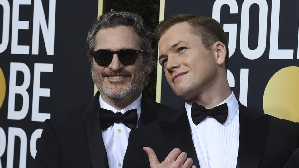 Joaquin Phoenix, left, and Taron Egerton arrive at the 77th annual Golden Globe Awards at the Beverly Hilton Hotel on Sunday, Jan. 5, 2020, in Beverly Hills, Calif. (Photo by Jordan Strauss/Invision/AP)