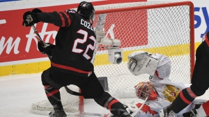 Canada's Dylan Cozens (22) scores past Russia goaltender Amir Miftakhov during second period gold medal game action at the World Junior Hockey Championships on Sunday, January 5, 2020 in Ostrava, Czech Republic. THE CANADIAN PRESS/Ryan Remiorz