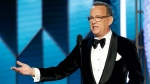 This image released by NBC shows Tom Hanks accepting the Cecil B. DeMille Award at the 77th Annual Golden Globe Awards at the Beverly Hilton Hotel in Beverly Hills, Calif., on Sunday, Jan. 5, 2020. (Paul Drinkwater/NBC via AP)