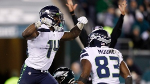 Seattle Seahawks' D.K. Metcalf, left, and David Moore celebrate after Metcalf's touchdown catch during the second half of an NFL wild-card playoff football game against the Philadelphia Eagles, Sunday, Jan. 5, 2020, in Philadelphia. (AP Photo/Julio Cortez)