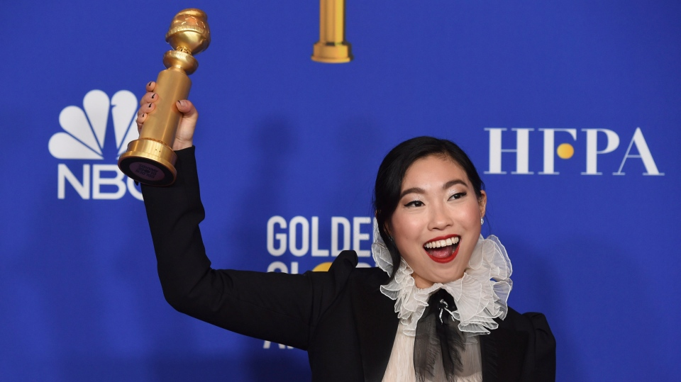 Awkwafina poses in the press room with the award for best performance by an actress in a motion picture, musical or comedy for