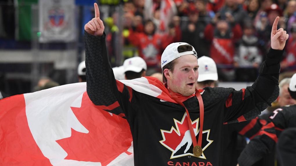 Canada's Alexis Lafreniere celebrates