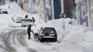 A man clears his driveway on Victoria Street in St. John's on Monday, January 6, 2020, following the first major snowstorm of the year. (THE CANADIAN PRESS/Paul Daly)